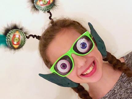 Girl wearing alien disguise